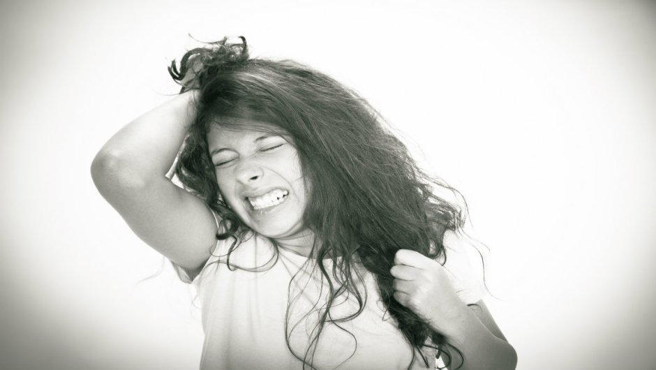 A frustrated woman pulling her hair