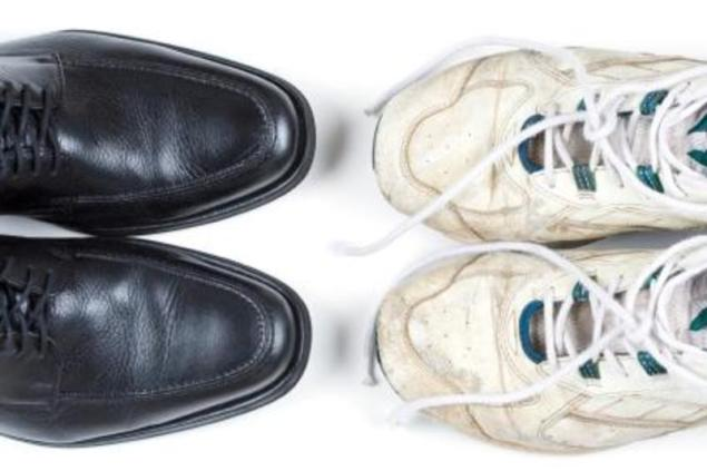 Two pairs of shoes – new business shoes and old tennis shoes