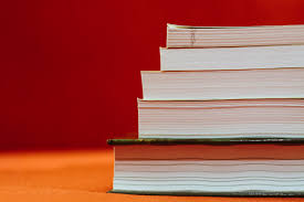 A stack of books against a red background