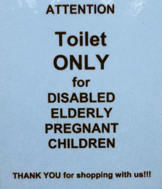 A sign reading: ATTENTION Toilet ONLY for DISABLED ELDERLY PREGNANT CHILDREN